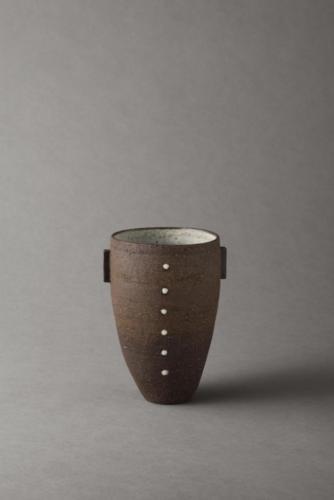 black vessel with porcelain dots