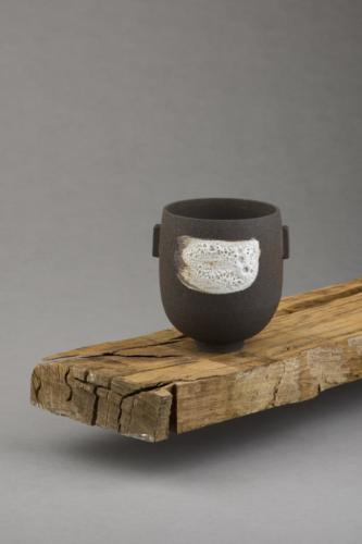 black vessel with lava glaze