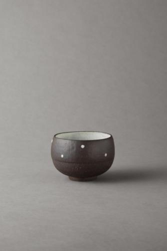 black bowl with porcelain dots