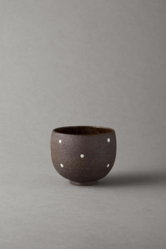 black bowl with porcelain dots